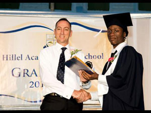 Kuti Ra (right) receives his International Baccaulaureate diploma from Nicholas Hazell, director at Hillel Academy