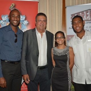 Director Sports Dalton Myers Phillip Gore with tennis scholarship recipients Serena Harjani and Theophilus Nelson